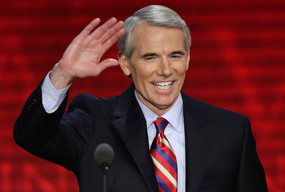 Photo - FILE - In this Aug. 29, 2012 file photo, Ohio Senator Rob Portman waves to the delegates during the Republican National Convention in Tampa, Fla. Portman said Thursday, March 14, 2013 that he now supports gay marriage and says his reversal on the issue began when he learned one of his sons is gay. (AP Photo/J. Scott Applewhite, File)