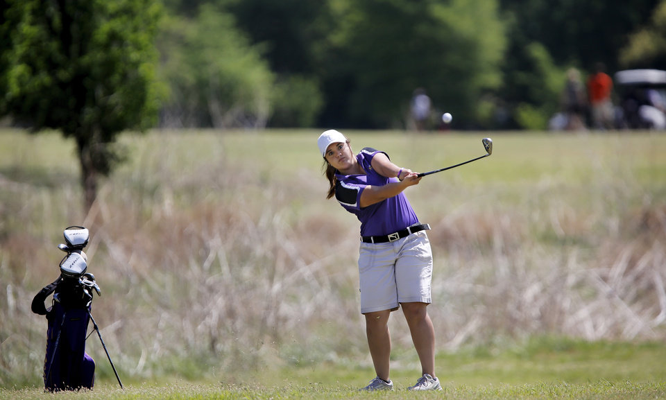 Photo - Lindsey Stahlman of Laverne hits her ball from outside the fairway during the 2014 Class 2A girls' golf state championship tournament  Wednesday, May 7, 2014, at Trosper Golf Course in Del City.  Photo by Jim Beckel, The Oklahoman