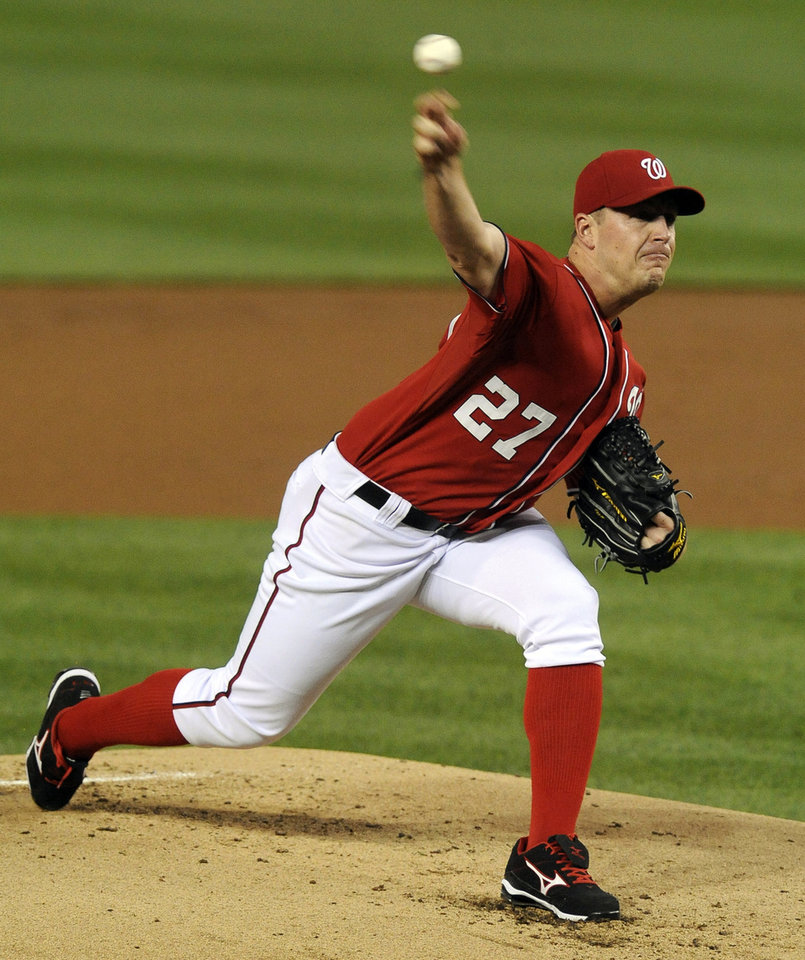 Photo -   Washington Nationals' starting pitcher Jordan Zimmermann delivers pitch in the second inning to a Philadelphia Phillies batter during their baseball game at Nationals Park, Sunday, May 6, 2012, in Washington. (AP Photo/Richard Lipski)