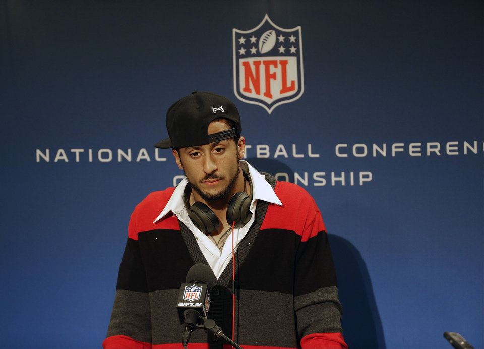 Photo - San Francisco 49ers quarterback Colin Kaepernick speaks during a news conference after the NFL football NFC Championship game against the Seattle Seahawks, Sunday, Jan. 19, 2014, in Seattle. The Seahawks won 23-17 to advance to Super Bowl XLVIII. (AP Photo/Ted S. Warren)