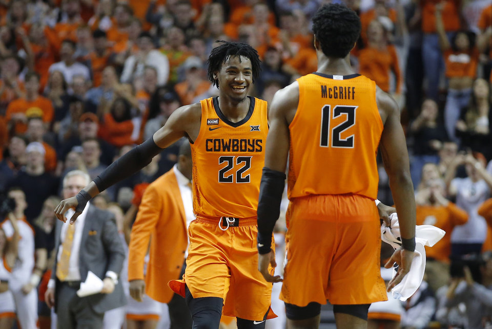 Photo - Oklahoma State's Kalib Boone (22) celebrates with Cameron McGriff (12) during an NCAA men's Bedlam basketball game between the Oklahoma State University Cowboys (OSU) and the University of Oklahoma Sooners (OU) at Gallagher-Iba Arena in Stillwater, Okla., Saturday, Feb. 22, 2020. Oklahoma State won 83-66. [Bryan Terry/The Oklahoman]