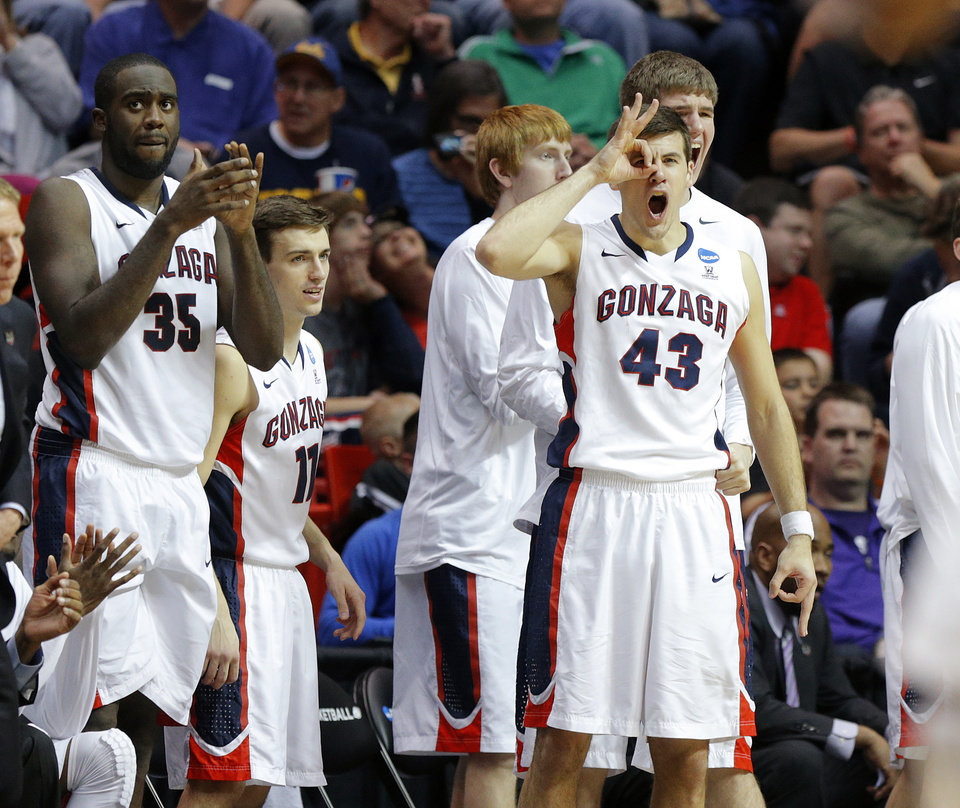 Photo - Gonzaga's Drew Barham (43) celebrates a 3-point basket during a second round game of the NCAA men's college basketball tournament at Viejas Arena in San Diego, between Oklahoma State and Gonzaga Friday, March 21, 2014. Gonzaga won 85-77. Photo by Bryan Terry, The Oklahoman