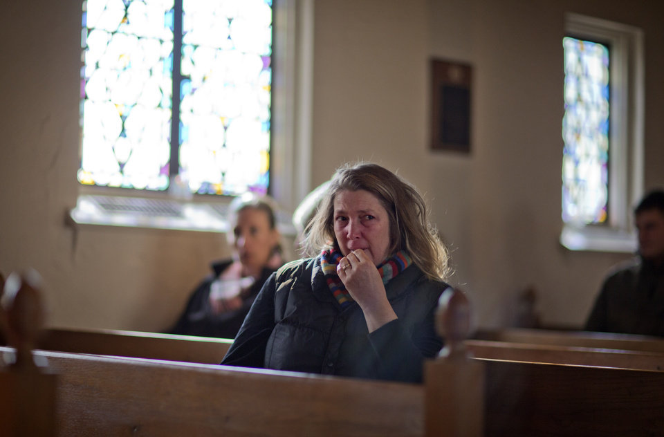 Photo - Mary Fellows,of Newtown, Conn., weeps while waiting for a prayer service to begin at St John's Episcopal Church, Saturday, Dec. 15, 2012, in Newtown.  The massacre of 26 children and adults at Sandy Hook Elementary school elicited horror and soul-searching around the world even as it raised more basic questions about why the gunman, 20-year-old Adam Lanza, would have been driven to such a crime and how he chose his victims. (AP Photo/David Goldman)