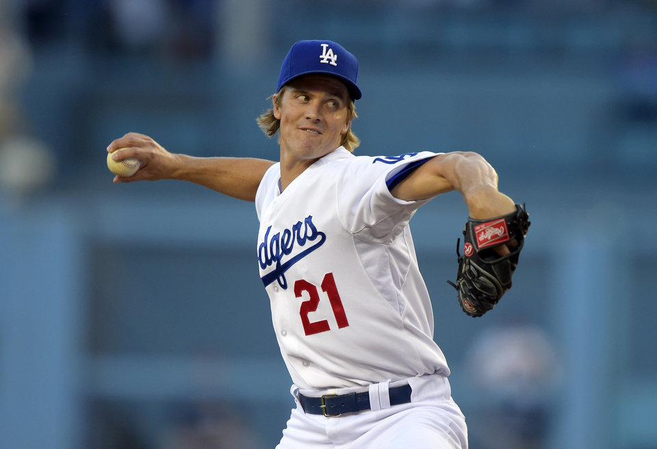 Photo - Los Angeles Dodgers starting pitcher Zack Greinke throws to the plate during the first inning of a baseball game against the Milwaukee Brewers, Friday, Aug. 15, 2014, in Los Angeles. (AP Photo/Mark J. Terrill)