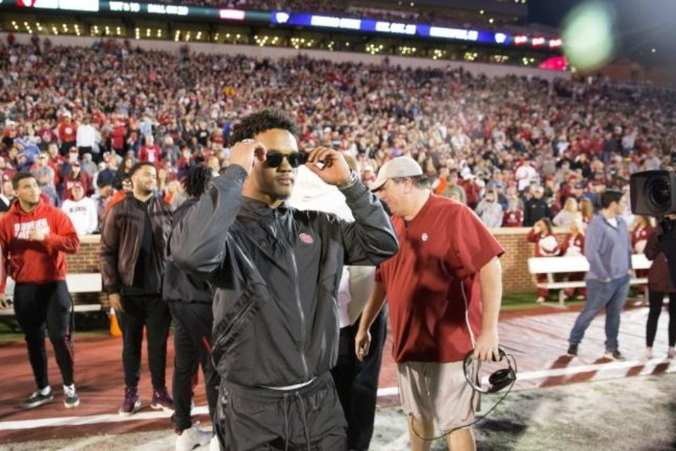 Photo -  With a future so bright that he needs to wear shades, former OU quarterback Kyler Murray watches Friday night's spring game on the sideline. [Bryan Terry/The Oklahoman]
