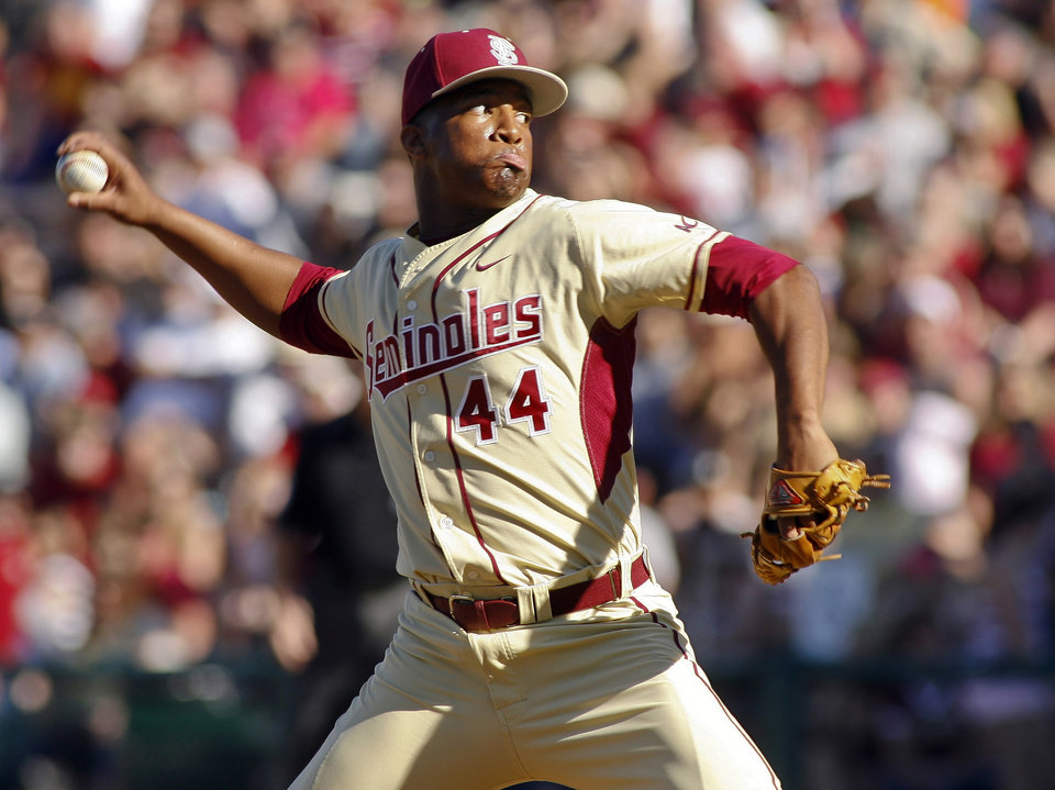 Photo - FILE - In this March 2, 2014, file photo, Florida State relief pitcher Jameis Winston throws in the ninth inning of an NCAA college baseball game against Miami in Tallahassee, Fla. The Florida State baseball team has indefinitely suspended Heisman Trophy winner Jameis Winston, who is a relief pitcher for the Seminoles. Baseball coach Mike Martin said in a statement Wednesday, April 30, 2014, that Winston was issued a citation the night before, but he did not give specifics. The Leon County Sheriff's Office has declined comment.  (AP Photo/Phil Sears, File)