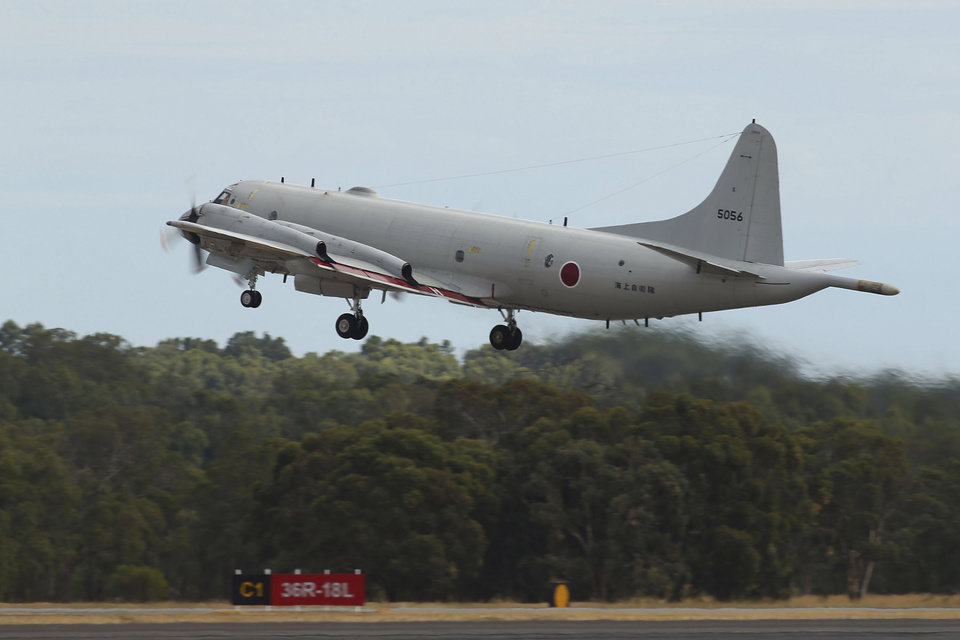 Photo - A Japan Maritime Self-Defense Force P-3C Orion takes off from the Royal Australian Air Force Pearce Base to commence a search for possible debris from the missing Malaysia Airlines flight MH370, in Perth, Australia, Monday, March 24, 2014. Satellite images released by Australia and China had earlier identified possible debris in an area that may be linked to the disappearance of the flight on March 8 with 239 people aboard. (AP Photo/Paul Kane, Pool)