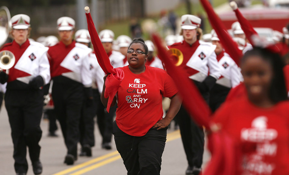 Johanna Brown, senior, marches with the band as part of the Color Guard unit.  Carl Albert High School is celebrating its 50th birthday this year and students and alumni participated in homecoming week activities, including a two-mile long parade before the football game on Friday, Oct. 12, 2012.    Photo by Jim Beckel, The Oklahoman