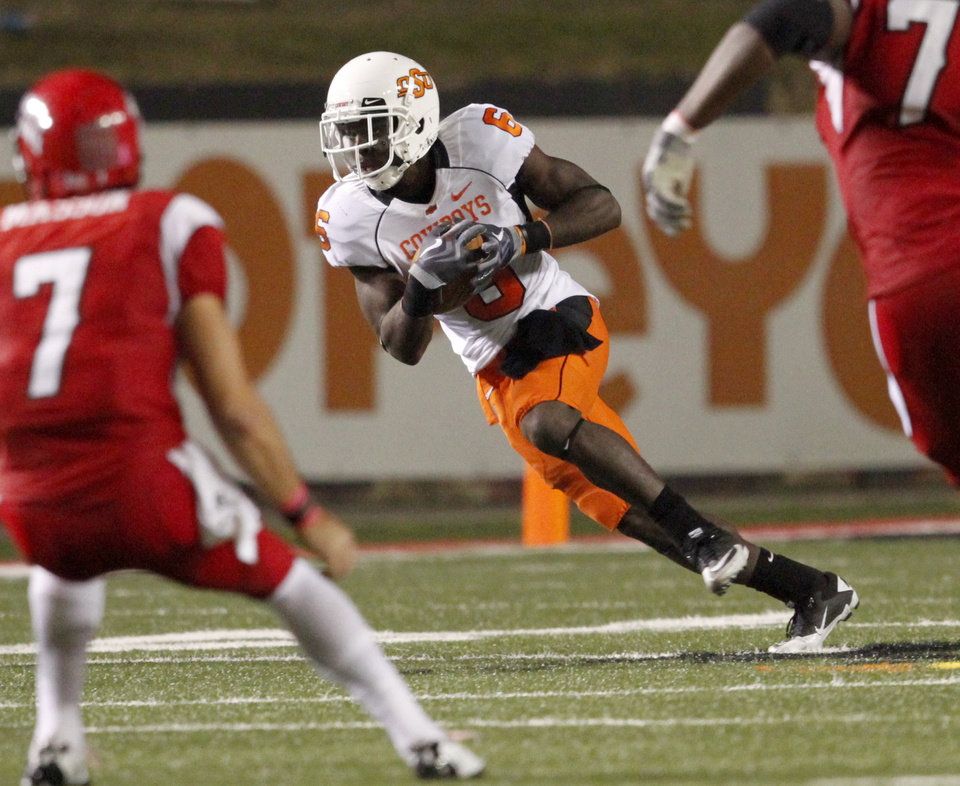 Photo - OSU's Andrew McGee runs after an interception during the football game between the University of Louisiana-Lafayette and Oklahoma State University at Cajun Field in Lafayette, La., Friday, October 8, 2010. Photo by Bryan Terry, The Oklahoman