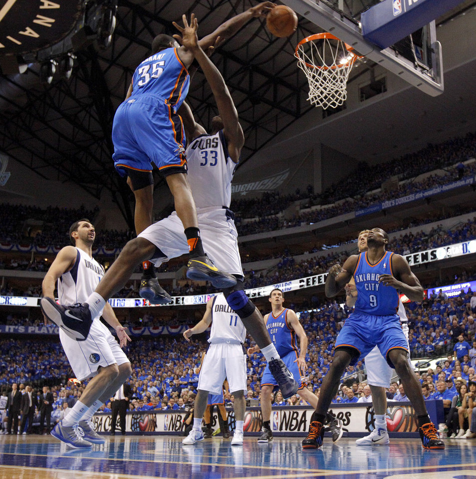 Photo - Oklahoma City's Kevin Durant (35) dunks the ball over Brendan Haywood (33) of Dallas during game 2 of the Western Conference Finals in the NBA basketball playoffs between the Dallas Mavericks and the Oklahoma City Thunder at American Airlines Center in Dallas, Thursday, May 19, 2011. Photo by Bryan Terry, The Oklahoman
