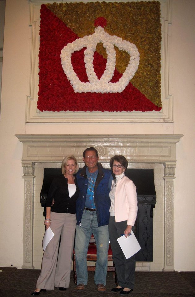 BALL PRACTICE....Lisa Pierce, Jim Vallion and Linda James pose before  the Beaux Arts Ball crown of flowers at the debutante and escort  rehearsal the day before the Ball. (Photo by Helen Ford Wallace).
