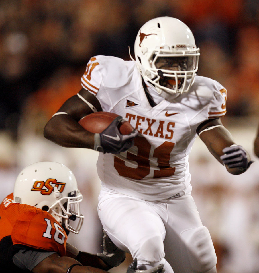 Photo - Texas' Cody Johnson (31) rushes as OSU's Perrish Cox (16) attempts to tackle him during the college football game between the Oklahoma State University Cowboys (OSU) and the University of Texas Longhorns (UT) at Boone Pickens Stadium in Stillwater, Okla., Saturday, Oct. 31, 2009. Photo by Sarah Phipps, The Oklahoman