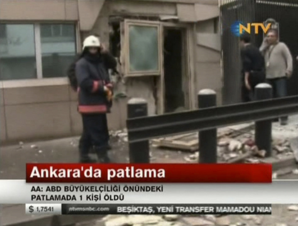 Photo - In this image made from video, emergency personnel are seen in front of a side entrance to the U.S. Embassy following a blast, Ankara, Turkey, Friday, Feb. 1, 2013. Turkish news reports say an explosion in front of the U.S. Embassy in the Turkish capital Ankara has injured several people. (AP Photo/NTV) TURKEY OUT