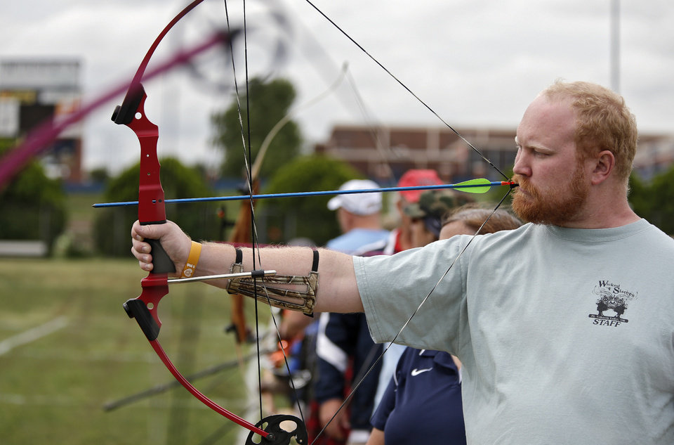 Jeff Hudgens, of Oklahoma, prepares to shoot in the archery clinic during the opening day of activities for the Endeavor Games at the University of Central Oklahoma on Thursday, June 6, 2013 in Edmond, Okla. Photo by Chris Landsberger, The Oklahoman
