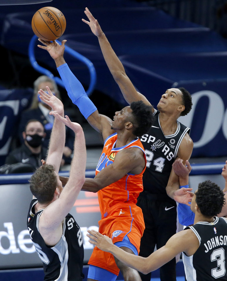 Photo - Oklahoma City's Hamidou Diallo (6) puts up a shot as San Antonio's Devin Vassell (24) and Jakob Poeltl (25) defend during an NBA basketball game between the Oklahoma City Thunder and the San Antonio Spurs at Chesapeake Energy Arena in Oklahoma City, Tuesday, Jan. 12, 2021. [Bryan Terry/The Oklahoman]