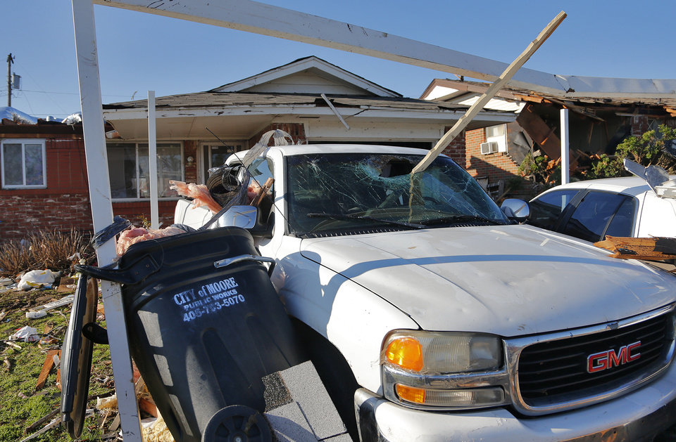 Photo -  Storm damage to a home in Moore on Thursday, March 26, 2015. A tornado hit the area on Wednesday evening, causing damage in the area.  Photo by Chris Landsberger, The Oklahoman