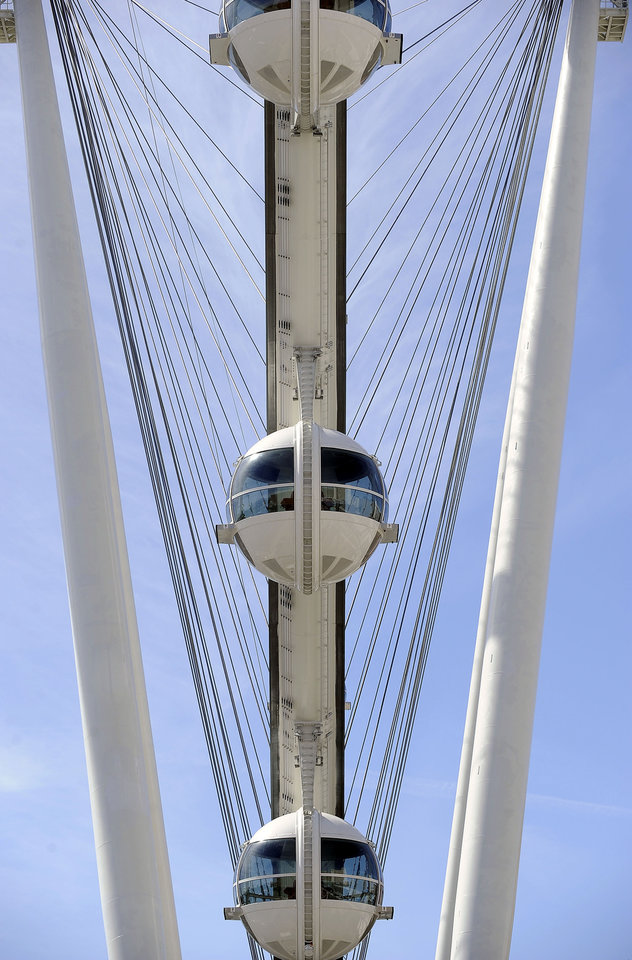 Photo - The Las Vegas High Roller at The LINQ is seen on March 31, 2014, in Las Vegas. The 550-foot-tall attraction, which opened to the public today, is the highest observation wheel in the world and features 28 cabins that can accommodate up to 40 people each. (AP Photo/David Becker)