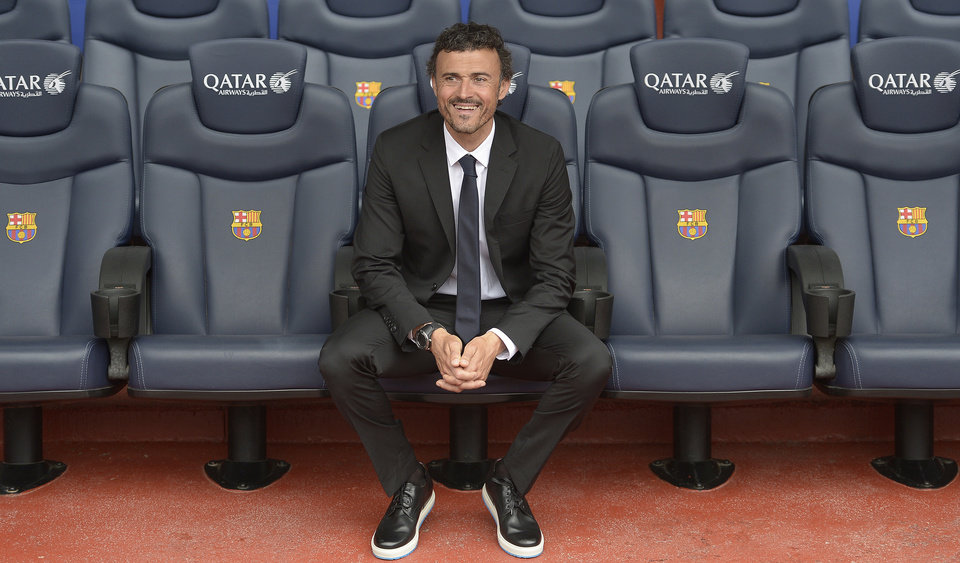 Photo - Luis Enrique smiles from the bench during his official presentation as new coach of FC Barcelona at the Camp Nou stadium in Barcelona, Spain, Wednesday, May 21, 2014. Luis Enrique looks on from the bench during his official presentation as new coach of FC Barcelona at the Camp Nou stadium in Barcelona, Spain, Wednesday, May 21, 2014. Former Barcelona player Luis Enrique signed a two-year contract to become coach on Wednesday, a hire the club hopes will resemble the success stories of Johan Cruyff and Pep Guardiola. (AP Photo/Manu Fernandez)