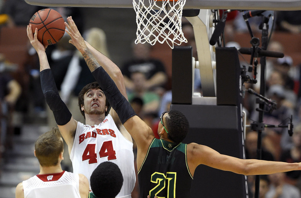 Photo - Wisconsin forward Frank Kaminsky (44) shoots over Baylor center Isaiah Austin (21) during an NCAA men's college basketball tournament regional semifinal, Thursday, March 27, 2014, in Anaheim, Calif. (AP Photo/Mark J. Terrill)