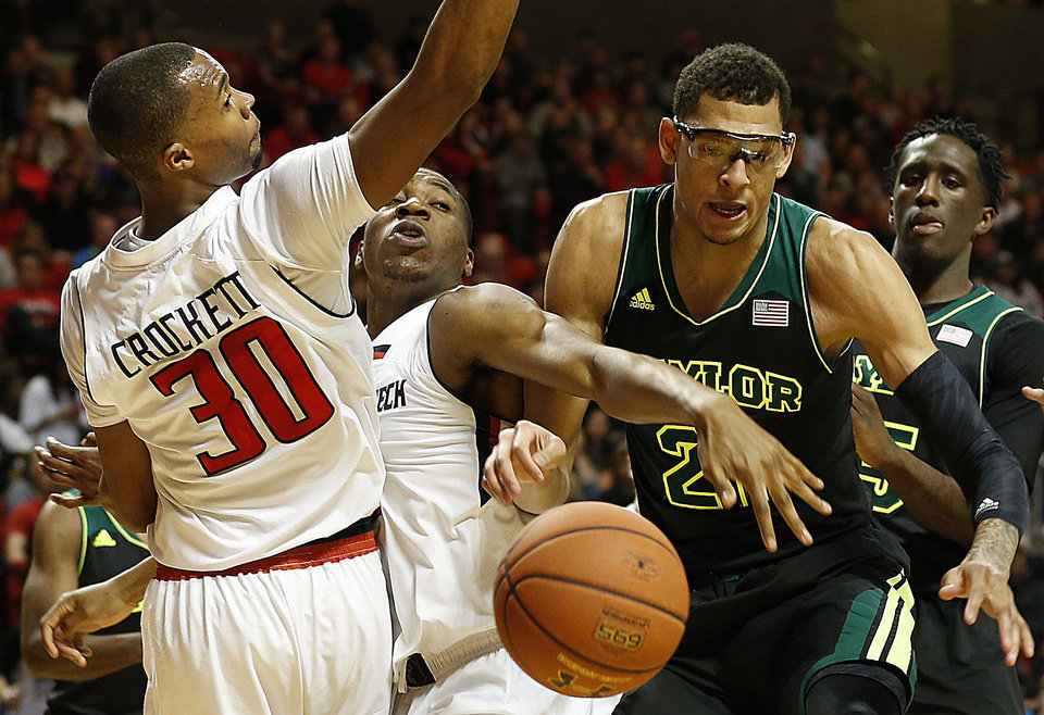 Photo - Texas Tech's Jaye Crockett (30) and Randy Onwuasor, center, battle for a loose ball against Baylor's Isaiah Austin (21) and Taurean Prince, right, during an NCAA college basketball game in Lubbock, Texas, Wednesday, Jan, 15, 2014. (AP Photo/Lubbock Avalanche-Journal, Tori Eichberger) ALL LOCAL TV OUT
