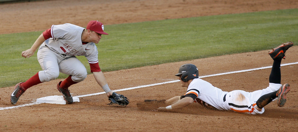Photo - OU'sSheldon Neuse tags out OSU's Gage Green at third base in the third inning of a Bedlam baseball game between the University of Oklahoma and Oklahoma State University at Chickasaw Bricktown Ballpark in Oklahoma City, Thursday, May 15, 2014. Photo by Bryan Terry, The Oklahoman