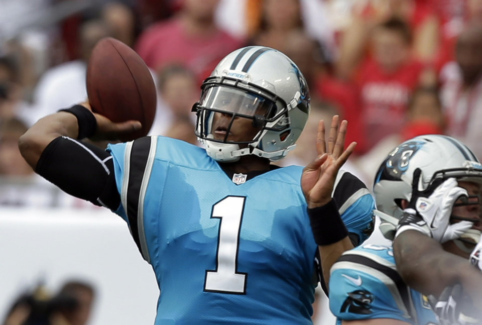 Photo -   Carolina Panthers quarterback Cam Newton throws a pass during the first quarter of an NFL football game against the Tampa Bay Buccaneers, Sunday, Sept. 9, 2012, in Tampa, Fla. (AP Photo/Chris O'Meara)