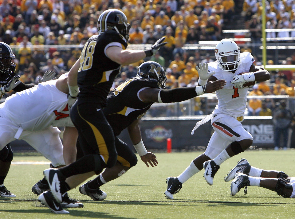 Oklahoma State's Joseph Randle (1) gets by the Missouri defense during a college football game between the Oklahoma State University Cowboys (OSU) and the University of Missouri Tigers (Mizzou) at Faurot Field in Columbia, Mo., Saturday, Oct. 22, 2011. Photo by Sarah Phipps, The Oklahoman