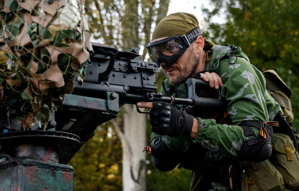 Photo - A Pro-Russian rebel prepares arms for the the assault on the positions of Ukrainian army in Donetsk airport, eastern Ukraine, Sunday, Aug. 31, 2014. Russian President Vladimir Putin on Sunday called on Ukraine to immediately start talks on a political solution to the crisis in eastern Ukraine. Hours later, Ukraine said a border guard vessel operating in the Azov Sea was attacked by land-based forces. (AP Photo/Mstislav Chernov)