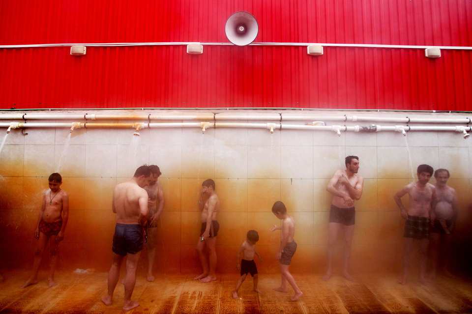 Photo - In this Feb. 19, 2014 photo, Iranian men shower at a hot mineral pool, in the northwestern town of Sarein, Iran. Spring-fed mineral baths on the slopes of Iran's Sabalan mountain draw patients seeking traditional hydrotherapy and tourists seeking a relaxing getaway. (AP Photo/Ebrahim Noroozi)