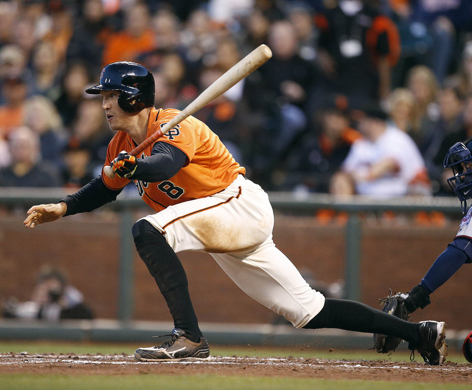 Photo - San Francisco Giants' Hunter Pence drives in a run against the Minnesota Twins in the third inning of a baseball game Friday, May 23, 2014, in San Francisco. (AP Photo/Tony Avelar)