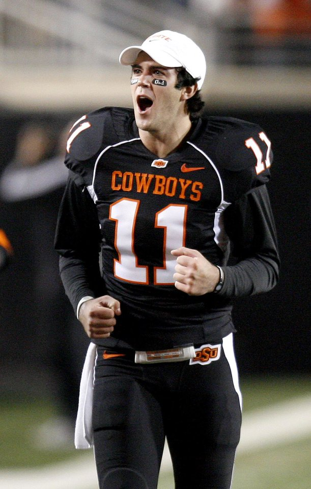 Photo - Zac Robinson of OSU celebrates during the college football game between Oklahoma State University (OSU) and the University of Colorado (CU) at Boone Pickens Stadium in Stillwater, Okla., Thursday, Nov. 19, 2009. Photo by Bryan Terry, The Oklahoman