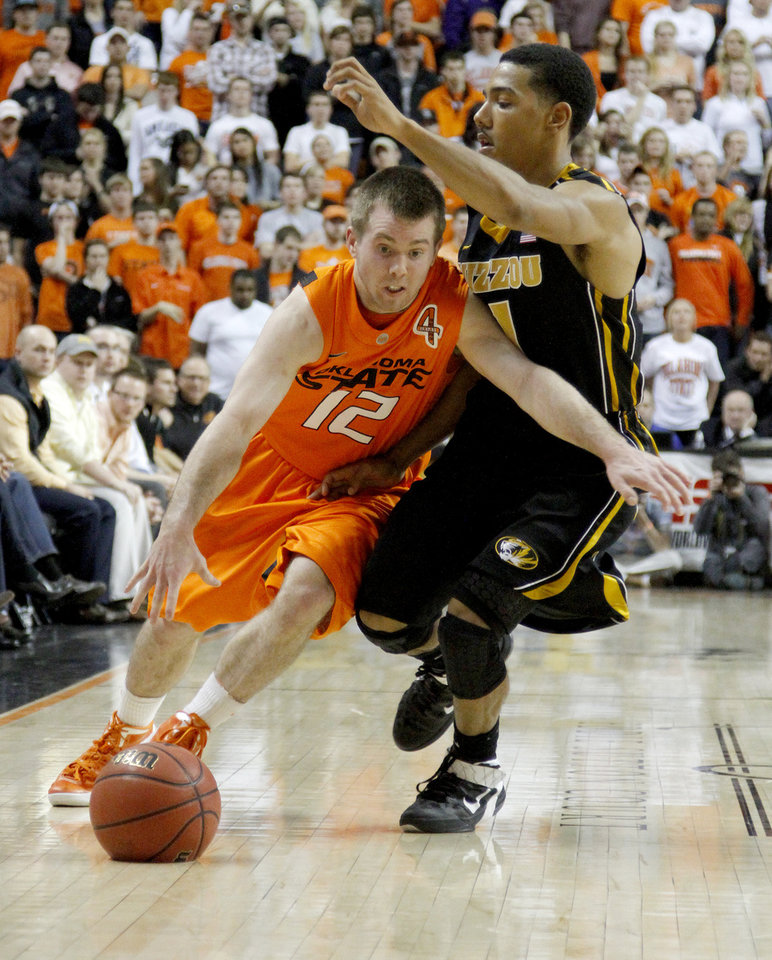 Oklahoma State\'s Keiton Page (12) drives around Missouri\'s Phil Pressey (1)during an NCAA college basketball game between the Oklahoma State University Cowboys (OSU) and the Missouri Tigers (MU) at Gallagher-Iba Arena in Stillwater, Okla., Wednesday, Jan. 25, 2012. Photo by Bryan Terry, The Oklahoman