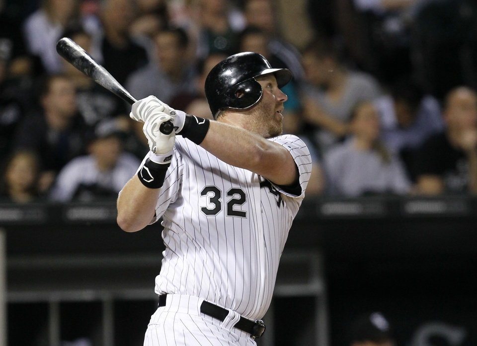 Chicago White Sox's Adam Dunn watches his home run off Cleveland Indians starting pitcher Josh Tomlin during the inning of a baseball game, Wednesday, May 2, 2012, in Chicago. (AP Photo/Charles Rex Arbogast)