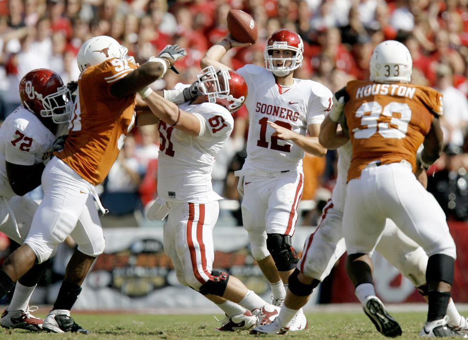 Photo - OU's Landry Jones throws a pass during the Red River Rivalry college football game between the University of Oklahoma Sooners (OU) and the University of Texas Longhorns (UT) at the Cotton Bowl in Dallas, Texas, Saturday, Oct. 17, 2009. Photo by Bryan Terry, The Oklahoman