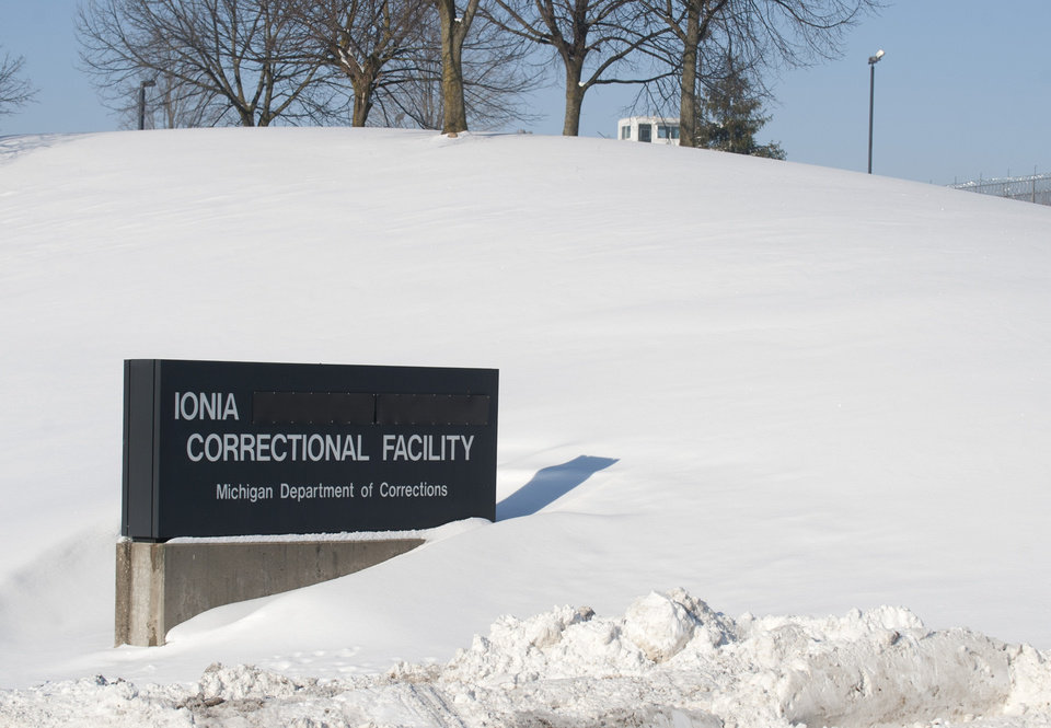 Photo - Snow blankets the Ionia Correctional Facility in Michigan Monday Feb. 3, 2014. A national manhunt is underway for convicted murderer  Michael Elliot  who escaped Sunday from the prison.    (AP Photo/The Grand Rapids Press, Chris Clark) ALL LOCAL TV OUT; LOCAL TV INTERNET OUT