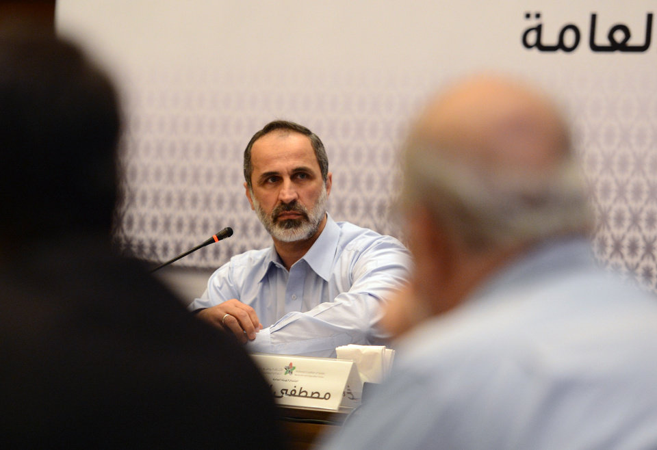 Photo - Head of the Syrian National Coalition for Opposition and Revolutionary Forces Mouaz al-Khatib speaks during a meeting in Istanbul, Turkey, Monday, March 18 2013. Syria's main opposition coalition began a push Monday to form an interim government to provide services to people living in parts of the country now controlled by rebel forces. al-Khatib claims that more than 70% of Syria has been