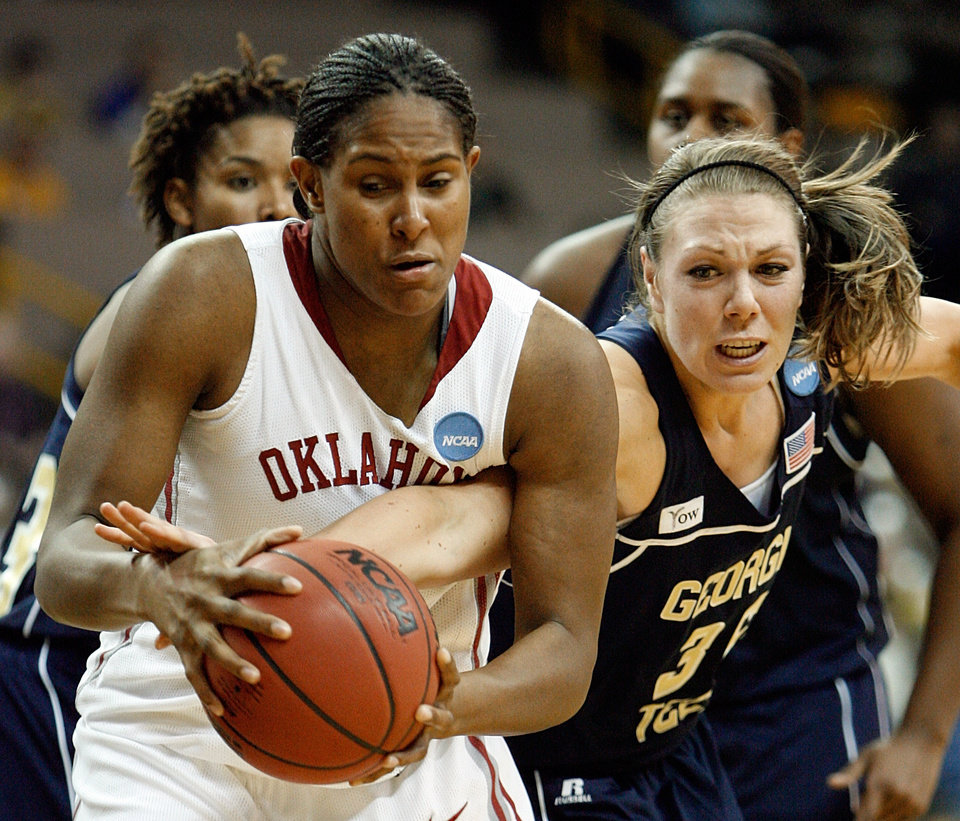 Photo - Brigitte Ardossi (35) reaches in as Ashley Paris tries to score in the second half as the University of Oklahoma (OU) plays Georgia Tech in round two of the 2009 NCAA Division I Women's Basketball Tournament at Carver-Hawkeye Arena at the University of Iowa in Iowa City, IA on Tuesday, March 24, 2009. 