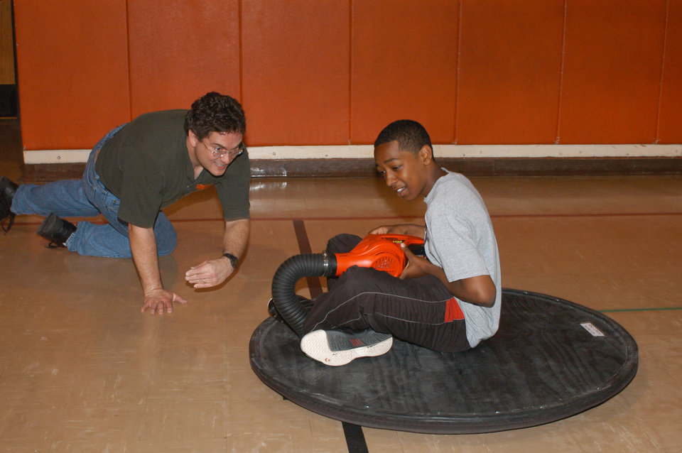 Rose State College Lab Assistant, Steve Lynch, gives a Cleveland Bailey Elementary Student a ride on the department's hover craft.<br/><b>Community Photo By:</b> Steve Reeves<br/><b>Submitted By:</b> natalie,