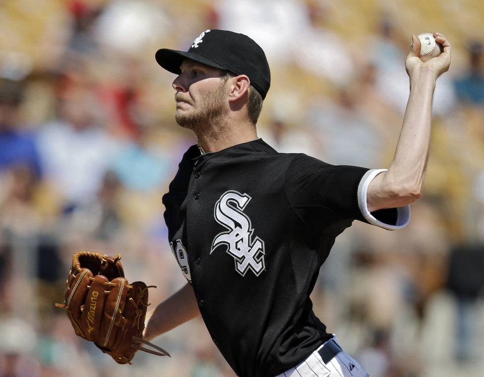 Photo - Chicago White Sox starting pitcher Chris Sale delivers against the Colorado Rockies in the third inning of a spring exhibition baseball game Tuesday, March 25, 2014, in Glendale, Ariz. (AP Photo/Mark Duncan)