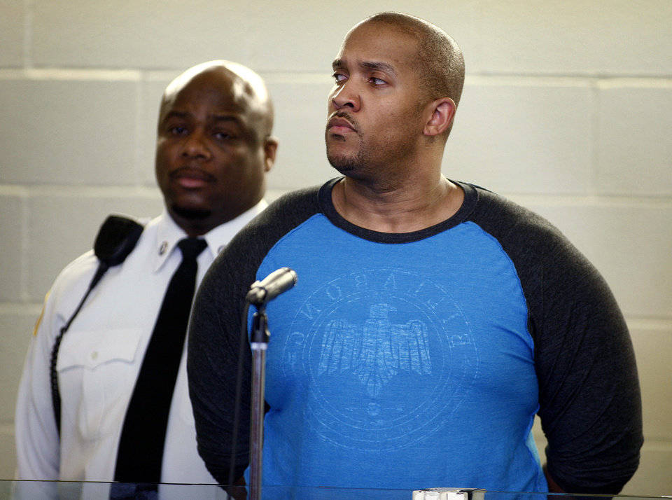 Photo - Gai Scott, right, of Randolph. Mass., stands during an arraignment, Monday, March 31, 2014, in Plymouth, Mass. Scott was arraigned on charges in the shooting of his uncle and reality TV star Benzino, who was shot Saturday during a funeral procession. (AP Photo/The Patriot Ledger, Greg Derr, Pool)