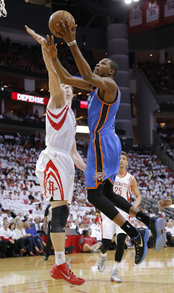 Photo - Oklahoma City's Kevin Durant (35) goes to the basket past Houston's Omer Asik (3) during Game 3 in the first round of the NBA playoffs between the Oklahoma City Thunder and the Houston Rockets at the Toyota Center in Houston, Texas, Sat., April 27, 2013. Oklahoma City won 104-101. Photo by Bryan Terry, The Oklahoman
