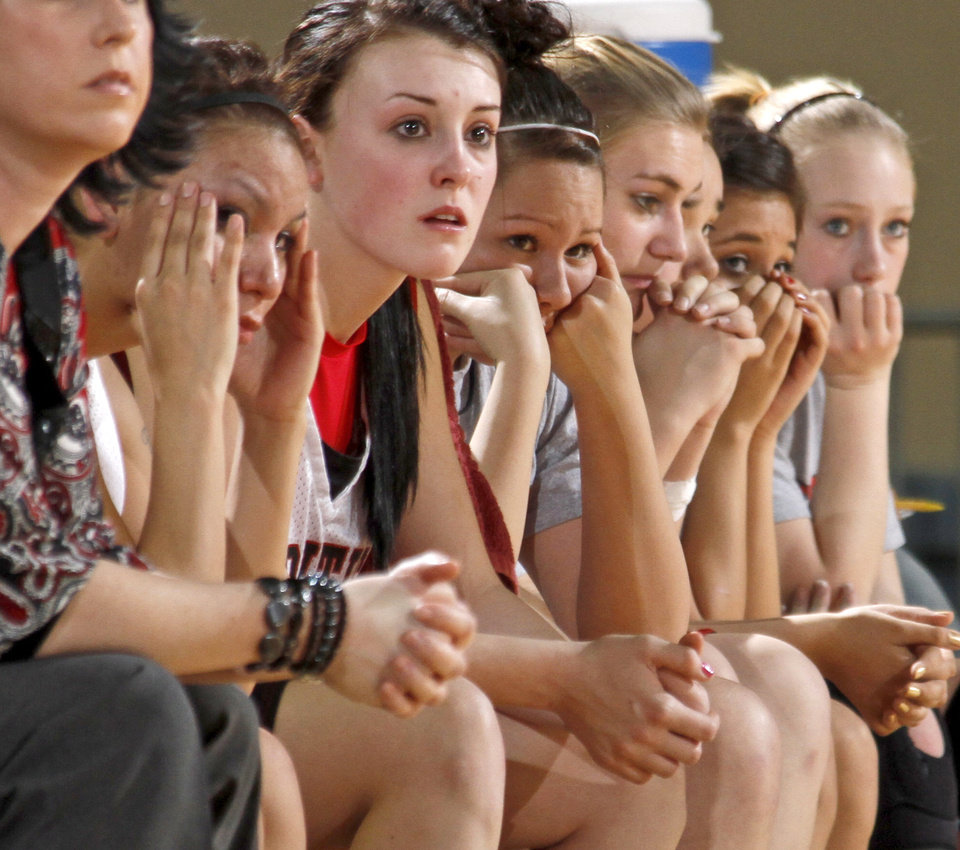 Photo - The Frontier bench, including Michelle Miner, left, and Tiffany Young, watch during the final minute of their loss to Boynton-Moton in the Class B girls basketball state tournament at the State Fair Arena in Oklahoma City, Friday, March 5, 2010.  Photo by Bryan Terry, The Oklahoman