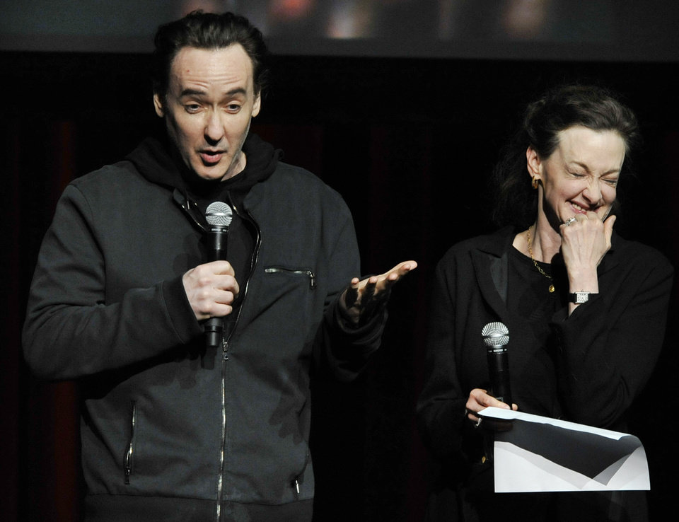 Photo - Actors John Cusack left, and Joan Cusack right, talk about Roger Ebert during a memorial for the film critic at The Chicago Theater in Chicago, Thursday, April 11, 2013. The Pulitzer Prize winning critic died last week at the age of 70 after a long battle with cancer. (AP Photo/Paul Beaty)