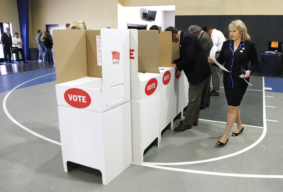 Photo - Gov. Mary Fallin walks to a voting booth to mark her ballot at precinct 137 in Oklahoma City Tuesday, Nov. 6, 2012.  Photo by Paul B. Southerland, The Oklahoman