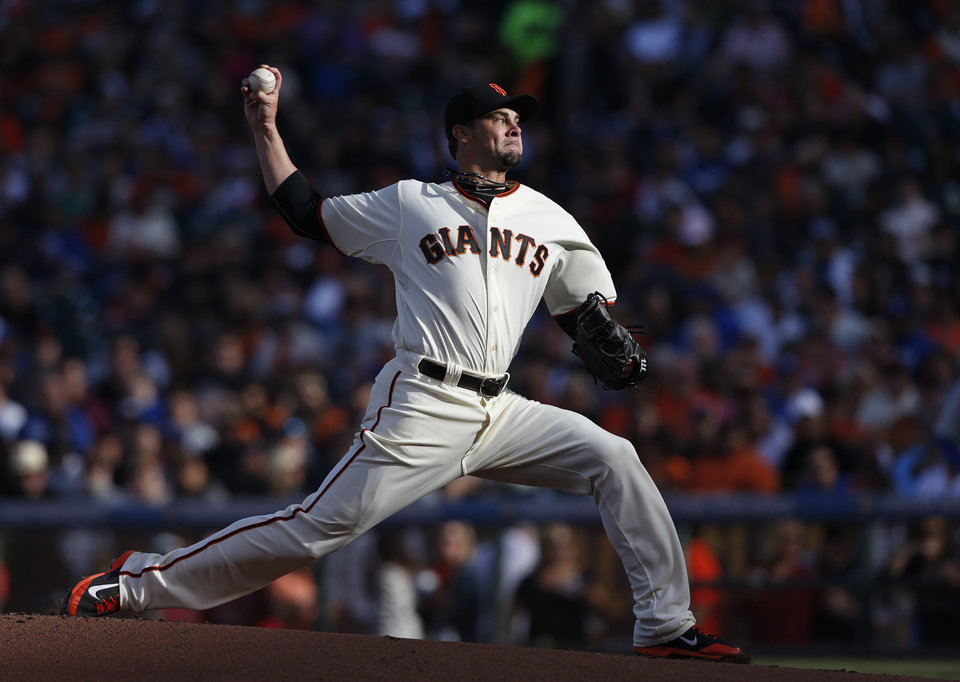 Photo - San Francisco Giants starting pitcher Ryan Vogelsong winds up during the first inning of a baseball game against the Los Angeles Dodgers, Saturday, July 26, 2014, in San Francisco. (AP Photo/Beck Diefenbach)