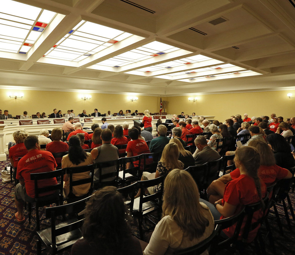 "Photo - This photo taken Monday, Aug. 18, 2014 shows hearings on legislation to repeal Common Core academic standards in the House Finance Hearing Room at Ohio Statehouse in Columbus, Ohio. Millions of students will sit down at computers this year to take new tests rooted in the Common Core standards for math and reading, but policymakers in many states are having buyer's remorse. The fight to repeal the standards has heated up in Ohio, where Republican legislators such as state Rep. Andy Thompson saying it's kind of ""creepy the way this whole thing landed in Ohio with all the things prepackaged."" (AP Photo/Columbus Dispatch, Kyle Robertson)"