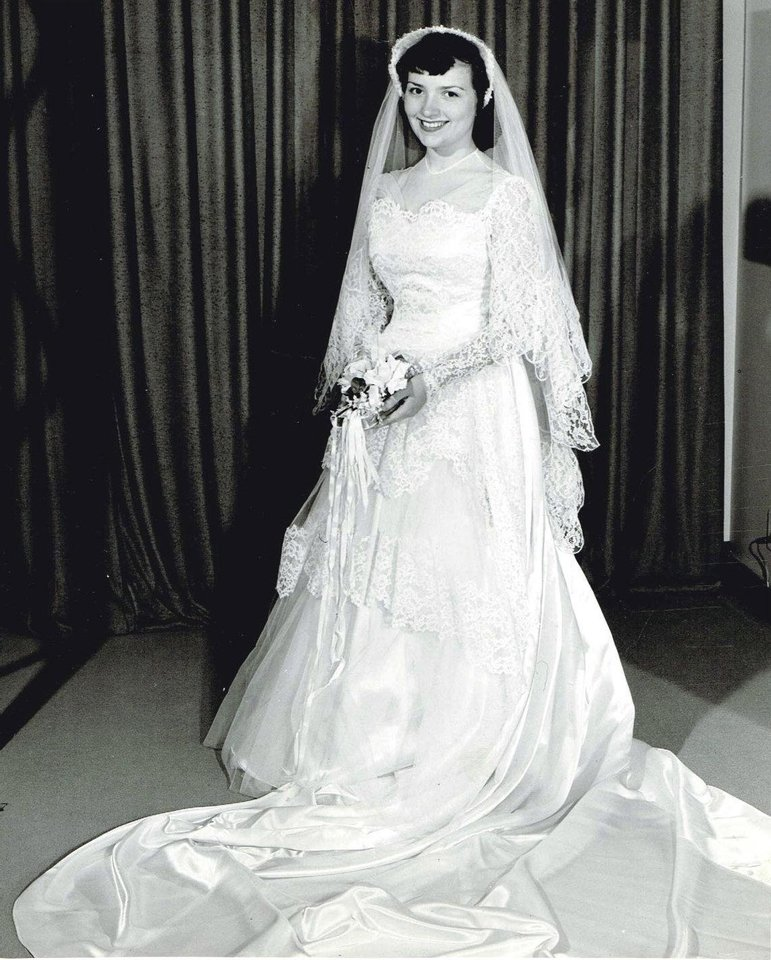 Photo - WEDDING DRESS: It was love at first sight when Leah Rae Hayes-Kessler laid eyes on her wedding gown for her June 5 wedding in 1953. Her gown embraced the decade with the lace tiers and short veil. The dress from Halliburton's in Oklahoma City was worth the $98. Five brides, including Hayes-Kessler, have walked down the aisle in this '50s style gown, said her daughter, Holly Heim. The other brides include Heim, her sister, sister-in-law and mother's best friend. Photo provided by Holly Heim