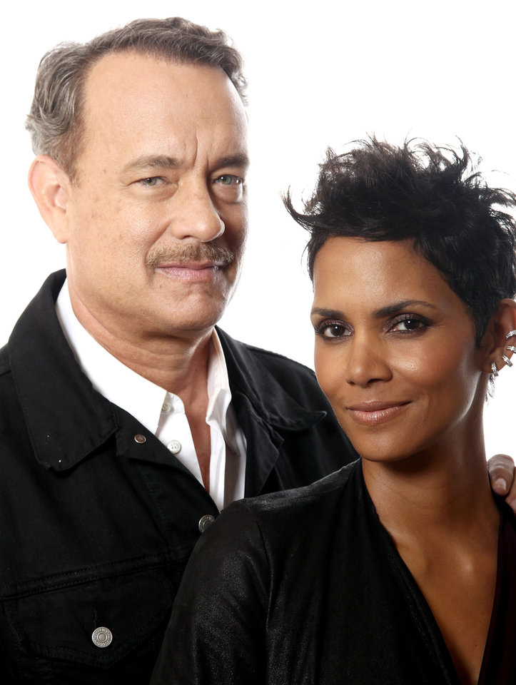 "In this Oct. 14, 2012 photo, actors Tom Hanks, left, and Halle Berry, from the upcoming film ""Cloud Atlas,"" pose for a portrait in Beverly Hills, Calif. The stars of ""Cloud Atlas,"" along with British author David Mitchell, who wrote the novel that inspired the genre-bending epic about souls returning and intertwining over the centuries, shared their beliefs and disbeliefs about reincarnation as the film heads to U.S. theaters Oct. 26, 2012. Hanks himself doesn't buy into reincarnation, while Berry, Whishaw, Mitchell, Sarandon and co-stars Hugo Weaving and Jim Sturgess either believe or at least think it's possible that souls come back for an encore. (Photo by Matt Sayles/Invision/AP)) ORG XMIT: CAENT409"