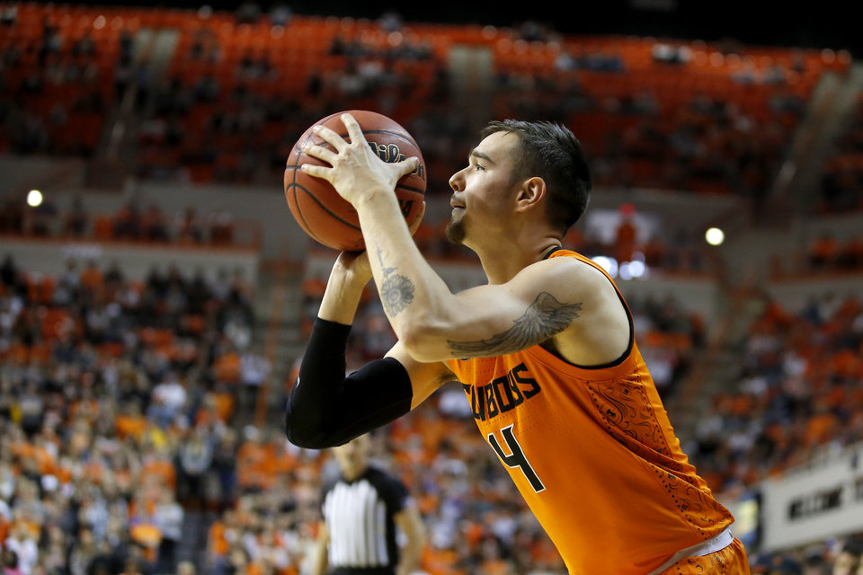 Photo - Oklahoma State's Thomas Dziagwa (4) makes a 3-pointer during an NCAA men's Bedlam basketball game between the Oklahoma State University Cowboys (OSU) and the University of Oklahoma Sooners (OU) at Gallagher-Iba Arena in Stillwater, Okla., Saturday, Feb. 22, 2020. Oklahoma State won 83-66. [Bryan Terry/The Oklahoman]