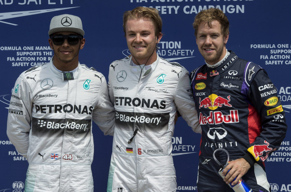 Photo - Mercedes driver Nico Rosberg, center, from Germany, teammate Lewis Hamilton, left, and Red Bull driver Sebastian Vettel, right, from Germany, pose after qualifying at the Canadian Grand Prix, Saturday, June 7, 2014, in Montreal. Rosberg finished first, Hamilton second and Vettel was third. (AP Photo/The Canadian Press, Paul Chiasson)